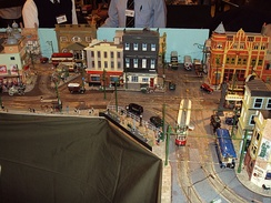 A model of a town with a tram model built into it.