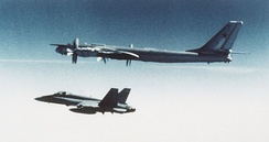 A Canadian CF-18 Hornet escorts a Soviet Tu-95 bomber, January, 1987. The Hornet was introduced in the 1980s as a multirole replacement for the service's fleet of CF-101 Voodoos, CF-104 Starfighters and CF-116 Freedom Fighters.
