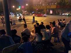 On the night of May 12, residents of Chengdu worried about potential aftershocks gathered in the street to avoid staying in buildings.