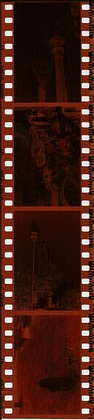 A strip of four color negatives on 35 mm film