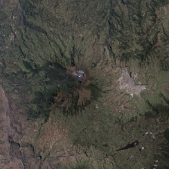 The Galeras Volcano, aerial image by NASA showing its activity. City of Pasto on the right.