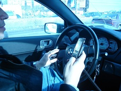 A driver using two handheld mobile phones at once