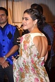Actress Kajol in a chiffon sari worn over a backless choli
