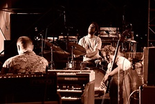 The Medeski, Martin and Wood organ trio demonstrates that an organ trio can come in different varieties; in place of a sax or electric guitarist, this band has an upright bass player as the third member.