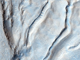 Ice sheet in Oxus Patera, a caldera in Arabia Terra. The scalloped nicks along the spines of the caldera's ridges are likely cracks caused by the expansion and contraction of ice.