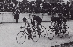 An outdoor track race in Paris in 1908 featuring Major Taylor, the first African-American cyclist to become world champion