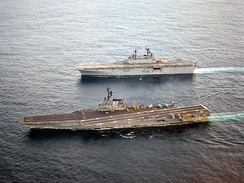 Wasp cruising alongside the aircraft carrier Coral Sea in September 1989