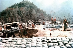 Marines complete construction of M101 howitzer positions at a mountain-top fire support base, 1968