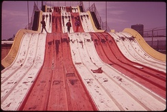 "A 1973 photo of an abandoned ""Giant Slide"" that had been set up for a few years on the old Steeplechase site"