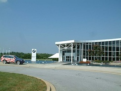"BMW Zentrum (visitor center) at the Spartanburg factory, with the ""Stars and Stripes"" X5 (E53).[1]"