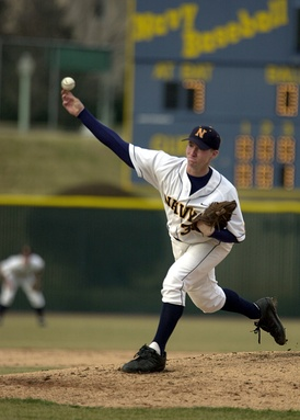 Navy pitcher Burgess Nichols Jr. moves forward off the rubber as the pitch is released