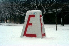 The Cairn painted with a large red 'E' for engineering