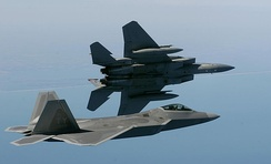 2005: An F-22 of the 43d Fighter Squadron flies alongside an F-15 Eagle of the 27th Fighter Squadron.