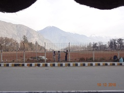 A picture of Gilgit Airport taken in the month of December 2015. Runway can be seen.