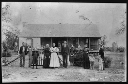 The Johnson Family in front of their home (later the birthplace of Lyndon Johnson). Sam Ealy Johnson Sr. (center) with family members. On his right is his wife: Eliza Bunton Johnson, to her right is her mother, Priscilla Jane McIntosh Bunton. in or near Stonewall, Texas.