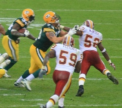 Fletcher (#59) pursuing Vernand Morency with Rocky McIntosh (#52) in 2007 season.