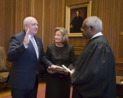 Perdue being sworn in by Justice Clarence Thomas in April 2017