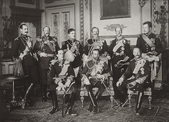 The Nine Sovereigns at Windsor for the funeral of King Edward VII, photographed on 20 May 1910. Standing, from left to right: King Haakon VII of Norway, Tsar Ferdinand of the Bulgarians, King Manuel II of Portugal and the Algarve, Kaiser Wilhelm II of Germany and Prussia, King George I of the Hellenes and King Albert I of the Belgians. Seated, from left to right: King Alfonso XIII of Spain, King George V of the United Kingdom and King Frederick VIII of Denmark.