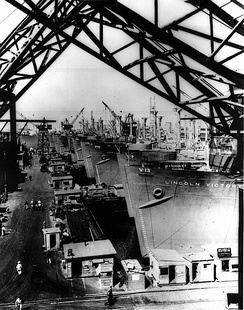 Victory Ships being fitted out at California Shipbuilding Corp. in 1944 (probably May or June).