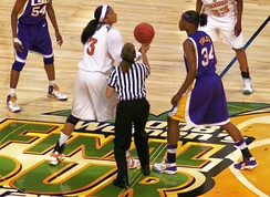 Parker (left) gets ready for the jump ball against Sylvia Fowles (right)