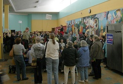 A 2008 Washington state Democratic caucus held in the school lunchroom of Eckstein Middle School in Seattle. In some states like Washington, voters attend local meetings run by the parties instead of polling places to cast their selections.