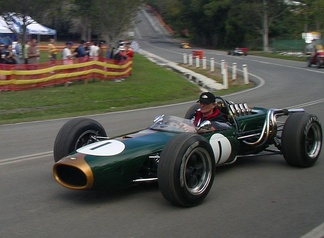 A green cigar-shaped racing car with exposed wheels and an open cockpit. The number one is painted on the nose and sides.