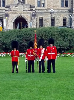 A colour guard with the regimental colour of the CGG on Parliament Hill.
