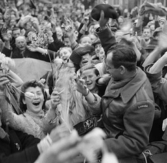 Dutch civilians celebrating the arrival of the I Canadian Corps in Utrecht as the Canadian Army liberates the Netherlands from Nazi occupation
