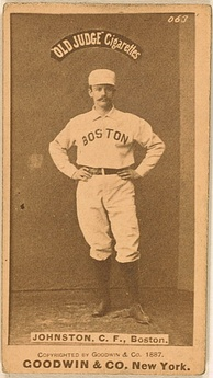 "A yellowed cigarette card. Pictured is a man in a white uniform with the words ""Boston"" curved on the uniform. The words ""OLD JUDGE Cigarettes"" are above the player."