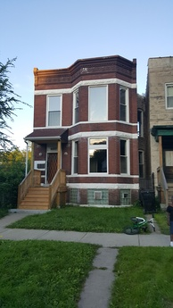 The Chicago two-flat at 6427 S. St. Lawrence Avenue where Emmett Till lived with his mother in mid-1955 [17]