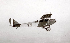 "A Curtiss JN-4 ""Jenny"" on a training flight during World War I. This is the type of aircraft used at March Field during this era for basic pilot training of military pilots."