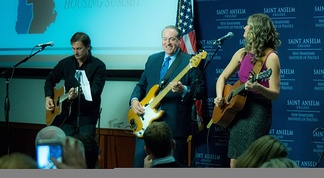 Huckabee plays bass guitar with recording artist Ayla Brown in 2015