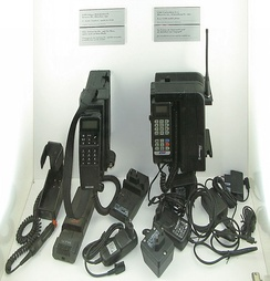 Two 1991 GSM mobile phones with several AC adapters