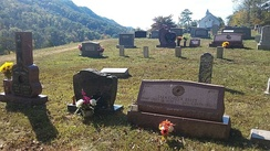 Grave of Janette Carter between her mother and brother, Joe