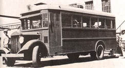 A Jewish bus equipped with wire screens to protect against rock, glass, and grenade throwing, late 1930s
