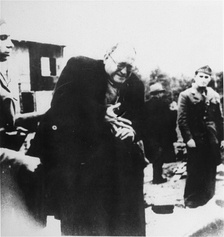 A Jewish prisoner is forced to remove his ring upon arrival in the Jasenovac concentration camp.