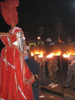 Carriers with lit flambeaux on Napoleon Avenue, just before the start of a parade, 2007