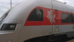 Lithuanian Railways passenger train decorated with coat of arms Vytis