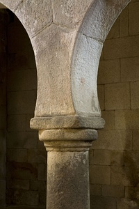 Simple capital of a Doric form supporting a Mozarabic arch, São Pedro de Lourosa Church, Portugal