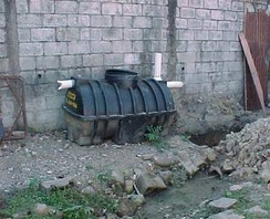A septic tank before installation, with manhole cover on top