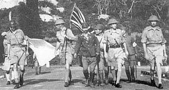 Lt Gen. Arthur Percival, led by a Japanese officer, walks under a flag of truce to negotiate the capitulation of Allied forces in Singapore, on 15 February 1942