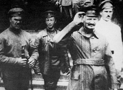 Trotsky (raising hand) with troops at the Polish front during the Polish–Soviet War, 1919