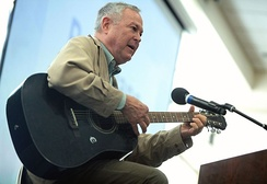 Rohrabacher plays guitar for attendees at the 2016 Young Americans for Liberty California State Convention