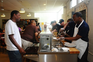Members of the United States Navy serving hungry Americans at a soup kitchen in Red Bank, N.J., during a community service project