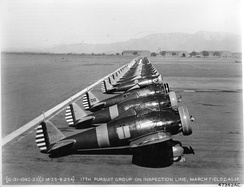 Boeing P-26A Peashooters of the 17th Pursuit Group, 18 February 1935. 33–102 sits in the foreground. These aircraft were later sent to the 1st Pursuit Squadron/Group of Philippine Air Force in 1937.