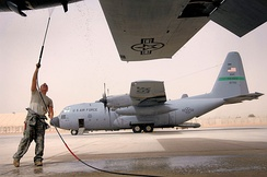 777th Expeditionary Airlift Squadron C-130 Hercules at Balad AB Iraq getting a power wash of the engines to ensure that built up dust does not get pulled into the intake during flight.