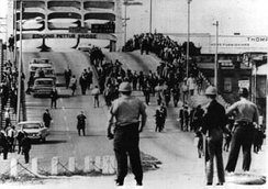 Alabama police prepare to assault peaceful demonstrators at the Edmund Pettus Bridge during Bloody Sunday in 1965
