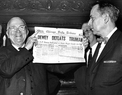 "Harry S. Truman holding newspaper titled ""Dewey Defeats Truman"" after winning victory over Thomas E. Dewey."