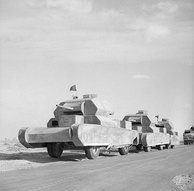 Dummy tanks, mounted on trucks, going to the forward areas in the Western Desert, 13 February 1942