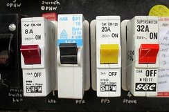Four one-pole miniature circuit breakers